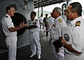 US Navy 110201-N-5620H-131 Capt. Thomas Stanley explains to Royal Malaysian navy First Adm. Anuwi and First Adm. Rosland, uses for the ship's dive.jpg