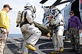 US Navy 110202-N-6692A-043 Sailors carry an injured Marine pilot from a simulated downed helicopter.jpg