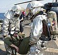 US Navy 110726-N-OV802-143 Sailors move a helicopter crash victim during a damage control drill aboard the guided-missile frigate USS Samuel B. Rob.jpg