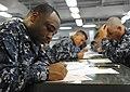 US Navy 110901-N-KD852-038 Electrician's Mate 2nd Class Carl Jones takes the E-6 advancement exam on the mess decks aboard the amphibious assault s.jpg