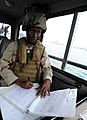 US Navy 120107-N-RP435-657 Boatswain's Mate Seaman Ashley Hightower, assigned to Maritime Expeditionary Squadron (MSRON) 2, observes and records en.jpg