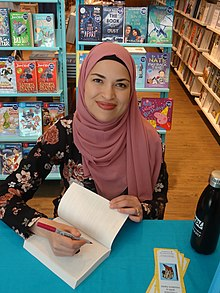 Uzma Jalaluddin signs her novel -a (48014876488).jpg