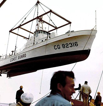 Coast Guard Squadron One - USCGC Point Mast (WPB-82316) being loaded on board a merchant ship for shipment to U.S. Naval Base Subic Bay, Philippines (May 1965)
