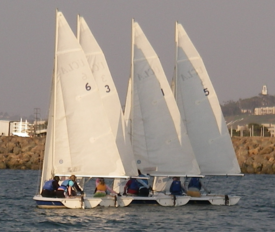 Vanguard 15 sailboats grouped on a run.png