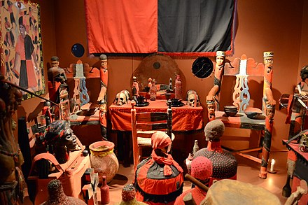 A selection of ritual items used in Vodou practice on display in the Canadian Museum of Civilization. Voodoo exhibit at the Canadian Museum of Civilization (8348740026).jpg