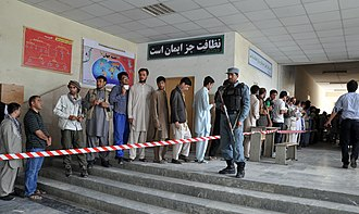 2014 Afghan presidential election - Voters queuing up in front of a polling center in Kabul during the 2014 presidential election.
