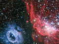 Wallpaper of two very different glowing gas clouds in the Large Magellanic Cloud.jpg