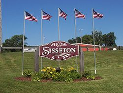 "A ""Welcome to Sisseton"" sign"