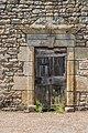 Wooden door at Rue Principale in Campagnac.jpg