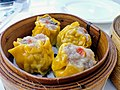 Yellow dim sum in steamer basket.jpg