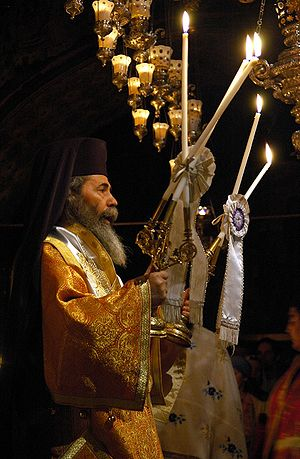 Dismissal (liturgy) - Patriarch Theophilus III of Jerusalem, giving the blessing with Dikirion and Trikion.