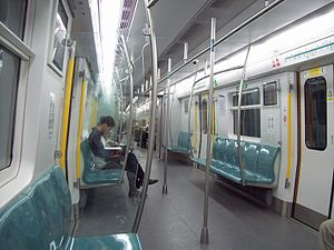 Line 4, Beijing Subway - Inside the train compartment of Line 4. It shares many design features with MTR trains