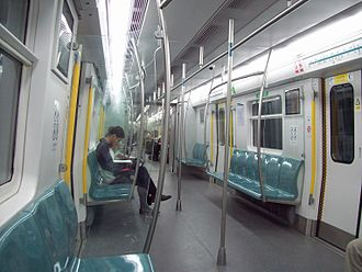 Line 4 (Beijing Subway) - Inside the train compartment of Line 4. It shares many design features with MTR trains
