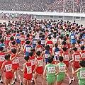 -Runners entering the Kim Il Sung stadium at the 2014 -Pyongyang -marathon (14104974393).jpg