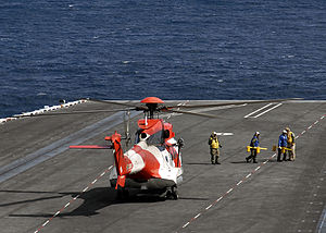 Atlas Oryx - A South African Air Force Oryx M2 helicopter preparing to take off from USS Theodore Roosevelt (CVN-71)