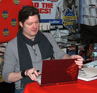 Planetary (comics) - Artist John Cassaday signing copies of the hardcover collection during an appearance at Midtown Comics