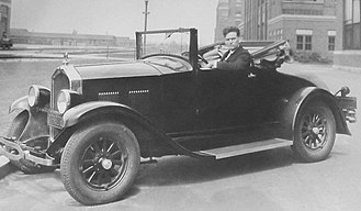 R. Tom Sawyer - 1920's Jordan automobile with R. Tom Sawyer, who successfully converted it to a hybrid-electric in 1928. He then drove it for 60,000 miles in the US and Australia as a demonstration of its capability