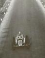 1935-06-16 Altopascio Alfa Bimotore Nuvolari above.png