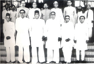 Sheikh Mujibur Rahman - Sheikh Mujib (standing second from left on bottom row) in the cabinet of A. K. Fazlul Huq in East Bengal, 1954