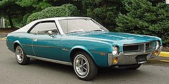 Shows a 1969 AMC Javelin finished in blue with optional white vinyl covered roof and Magnum 500 wheels