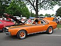1970 AMC AMX in orange with a 401 and custom wheels.jpg