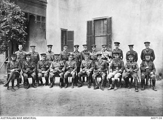 John Gellibrand - Group portrait of 1st Division staff Officers at Mena Camp. Gellibrand is in the front row, third from the left.