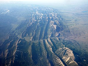 Rocky Mountain Front - Aerial view of a cross-section of the Lewis Overthrust, facing north.  The Rocky Mountain Front is on the right.