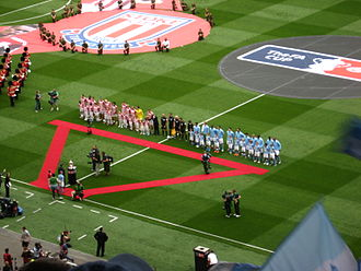 2011 FA Cup Final - The teams line up before the match with Stoke City in red-and-white stripes and Manchester City in sky blue.