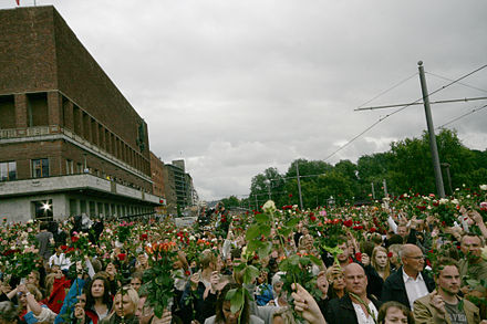 Town Hall Square in Oslo filled with people with roses mourning the victims of the Utoya massacre, 22 July 2011 2011 Norway attacks flower march 2.jpg