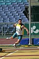 291000 - Athletics field discus F12 Russell Short gold action 3 - 3b - 2000 Sydney event photo.jpg