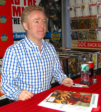 Ultimate Comics: Avengers - Writer Mark Millar signing a copy of the first issue during an appearance at Midtown Comics in Manhattan.