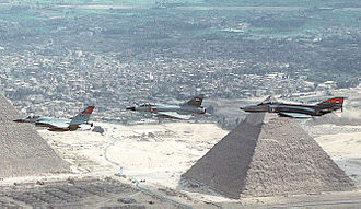 "Operation Bright Star - A General Dynamics F-16C Fighting Falcon, a Dasault Mirage 2000EM, and an McDonnell Douglas F-4E Phantom II of the Egyptian Air Force in flight over Khafre's Pyramid during Exercise ""Bright Star 94"""