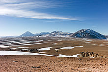 Mountain across a plateau, dwarfing a radio telescope in the foreground