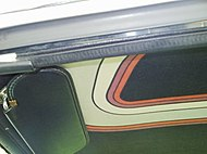 Shows the headliner inside the car that also featured the fashion designer's stripes