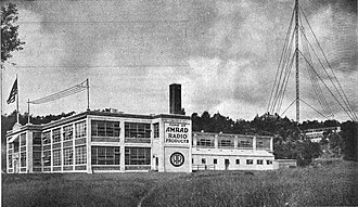 "WGI (defunct) - ""Main Factory of the American Radio and Research Corporation. Medford Hillside, Mass. Home of Amrad Radio. Showing at extreme right Research and Engineering Laboratories and Broadcasting Station WGI, the Pioneer Radiophone for Broadcasting to the Layman Public."" (Caption from 1922 company advertisement)"
