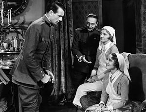 Medium shot - An example of a medium group shot featuring Gary Cooper and Adolphe Menjou from the 1932 drama film A Farewell to Arms