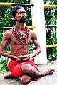 A Saint praying lord Siva at Ambubasi Mela.jpg