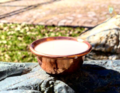 A bowl of milk for the shaman rite. Buryatia. Russia.png