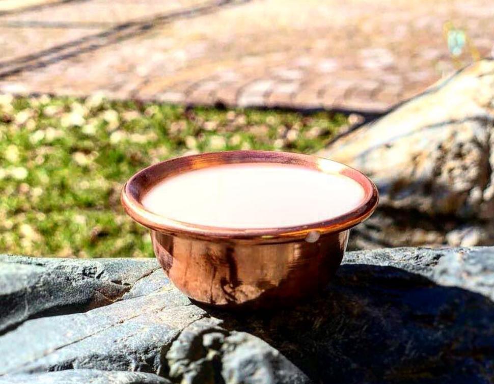 A bowl of milk for the shaman rite. Buryatia. Russia