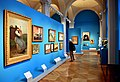 A man scrutinizes a painting, one of the halls at the Nationalmuseum, Stockholm, Sweden.jpg