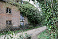 Abandoned mill at Tilty, Essex, England, 01 - East face and path from SE.jpg