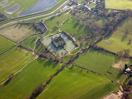 An Aerial View Of The Bodiam. The Square Castle Is Surrounded By A Roughly  Square