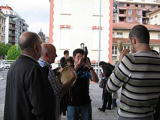 Basque music - Alboka players and a tambourine man playing a tune together
