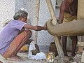 An artist making statues for Dasehra.jpg