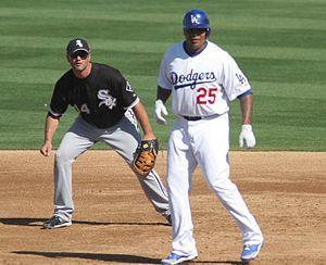 Andruw Jones - Jones (25) with White Sox first baseman Paul Konerko during spring training action, 2008.