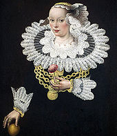 A seventeenth-century painting of a woman wearing a ruff, the decorative collar from which the English name of the bird derives. She is wearing a black dress with a particularly large and elaborate white lacy ruff, and holds a flower in her left hand.