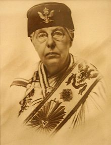 Photograph (sepia tint) of Annie Besant in masonic gown, hat and sash