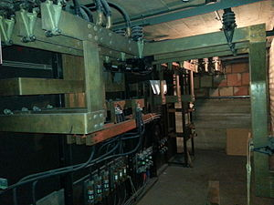 Electrical room - The back of an antique electrical room, still operational at a US plant as of 2014. All conducting busbars are open and operators must be careful not to touch them.