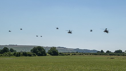 Eight Apache attack helicopters of 3 Regiment Army Air Corps during Exercise Talon Gravis, 2019. Apache attack helicopters over Suffolk during Exercise Talon Gravis.jpg