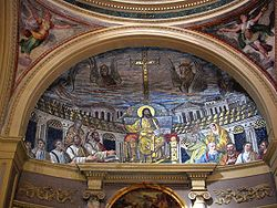 The curved surface of the roof of an apse is decorated with the scene of Christ in Majesty. He is robed in gold, seated on a throne in front of a depiction of the Holy City. The apostles look up at him, while Saint Pudenziana and her sister Prasede stand to either side carrying laurel wreaths. In the sky are shown the Four Holy Beasts, symbols of the Gospel writers.